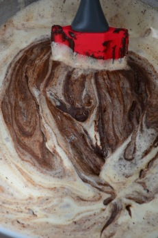 Add melted chocolate to egg mixture