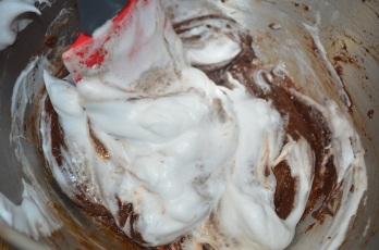 Gradually add stiff peaks egg whites with chocolate batter