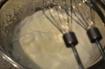 Whisk egg whites until soft peaks