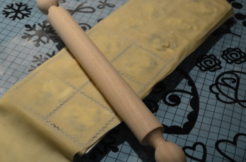 Use rolling pin to level the top and cut each square