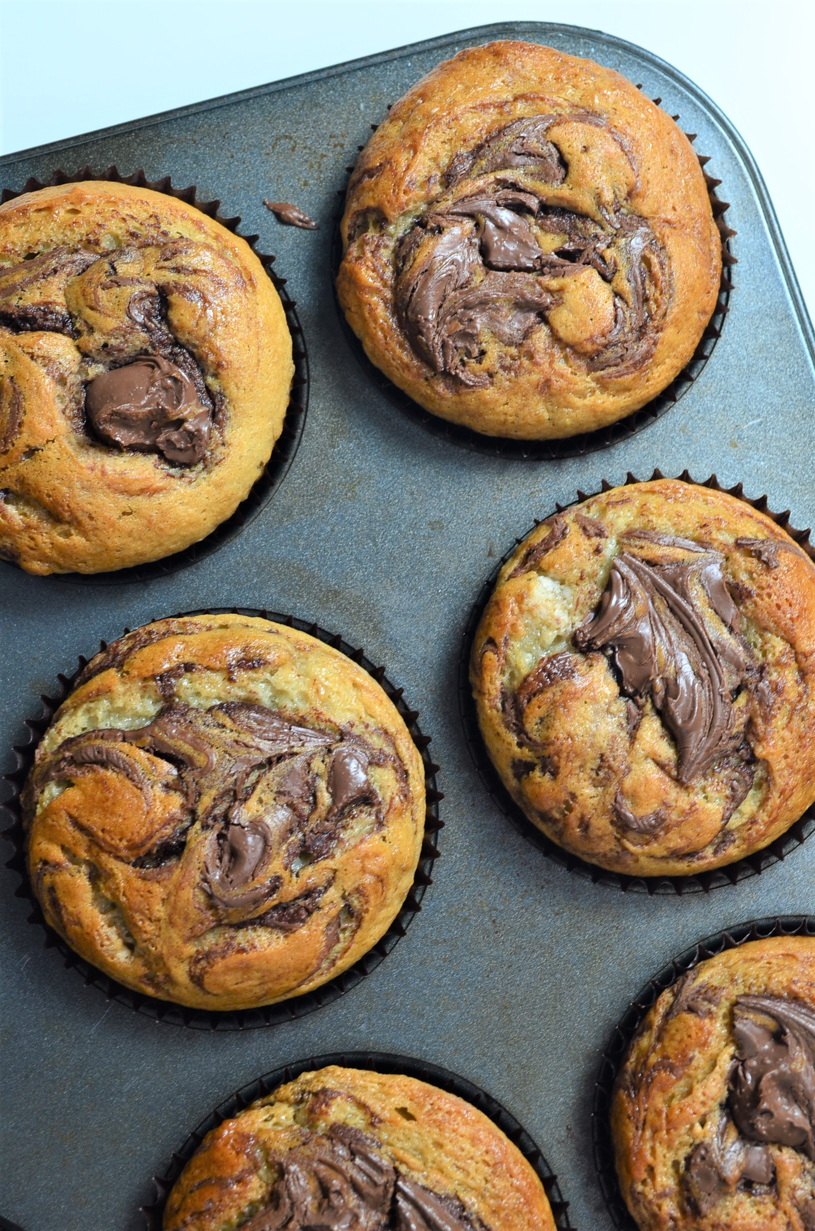 Nutella Swirl Banana Muffins at SweetNSPicyLiving.com