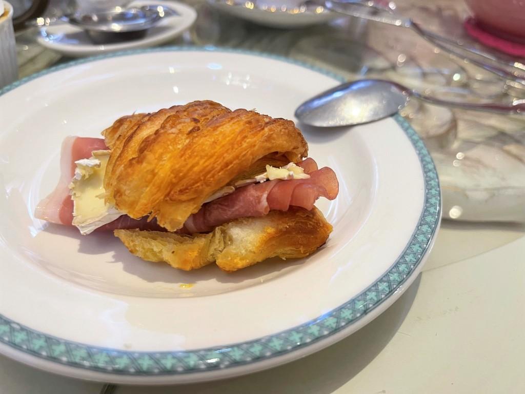 Prosciutto, brie and fresh basil croissant sandwich